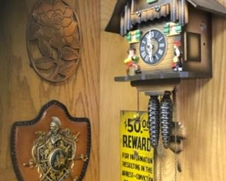 Old sign, cuckoo clock, coat of arms