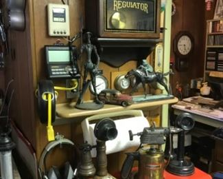 Old Regulator clock, craftsman tool box full of tools, antique phones, bronze jockey, cast iron Don Quixote, brass blow torch