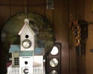 Bird house with large advertising piece in background