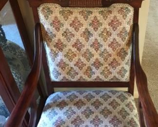 Beautiful carved arm chair, nicely upholstered