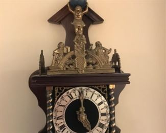 Lovely cuckoo clock with ornate brass trim