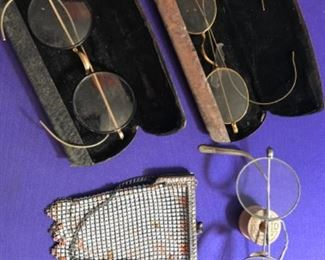 antique eye glasses and metal purse