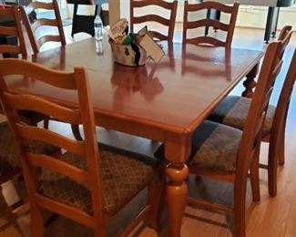 Custom Farmers Table from Bassett Furniture. Solid Oak wood, comes with 8 chairs, and leaf in center. Table can be either Oval or square shape. Cushions need sprucing or can be reupholstered. $650