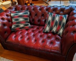 Chesterfield settee in red leather