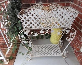 Heavy wrought iron basket is removable from the stand