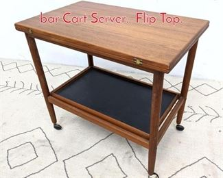 Lot 1062 Danish Modern Teak Rolling bar Cart Server. Flip Top.