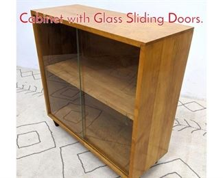 Lot 1133 PAUL MCCOBB Bookcase Cabinet with Glass Sliding Doors.