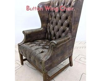 Lot 1144 Chesterfield Style Tufted Button Wing Chair.