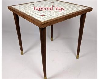 Lot 1469 Masaic top table with tapered legs.