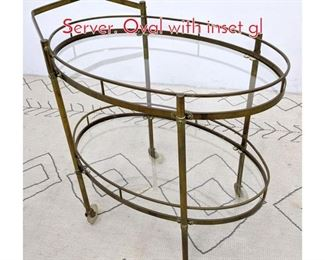 Lot 1180 Italian Style Brass Bar Cart Server. Oval with inset gl