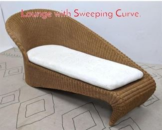 Lot 1207 Designer Rattan Chaise Lounge with Sweeping Curve.