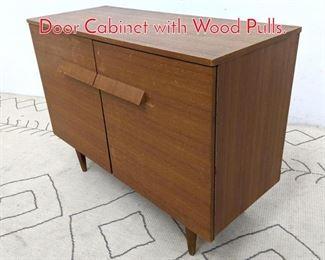 Lot 1339 Mid Century Modern Teak 2 Door Cabinet with Wood Pulls.