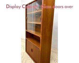 Lot 1343 DYRLUND Danish Teak Display Cabinet. Glass doors over