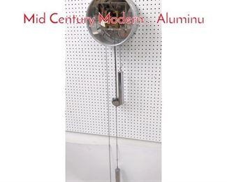 Lot 1348 Howard Miller Wall Clock. Mid Century Modern . Aluminu