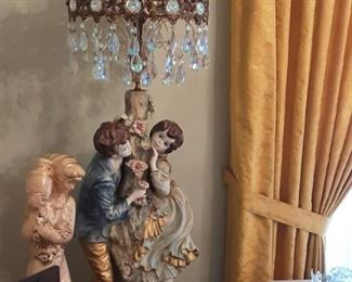 Full view of Double Figure (Boy & Girl) Capodimonte Table Lamp with Crystal prism Shade.  Women with vase Ceramic statue.