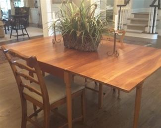 Antique,  solid cherry drop leaf table by Stickley