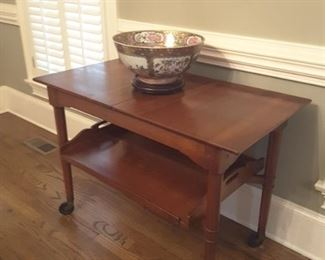Antique solid cherry tea cart by Stickley...note butlers tray underneath.