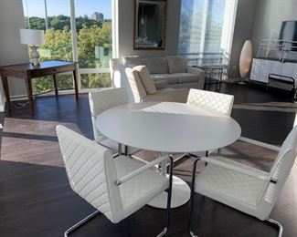 "Enjoy your morning coffee or breakfast sitting at this fabulous white pedestal kitchen table with 4 upholstered arm chairs. Chairs provide wonderful support and ease of getting up. Table dimensions are 48""W X 30""  (Picture 1 of 3). Sale Price $2,000"