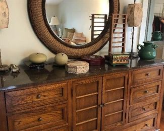 Walnut dresser with stone top and round mirror, jewelry boxes and more