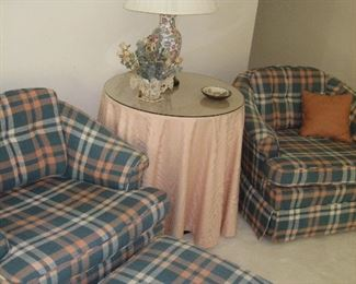 Upholstered chairs and ottoman