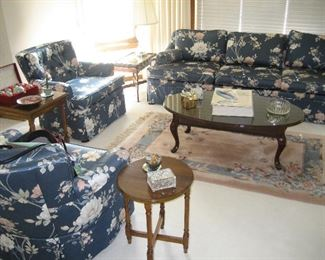 Upholstered sofa and side chairs, Queen Anne coffee table, occasional tables, Chinese pattern rug