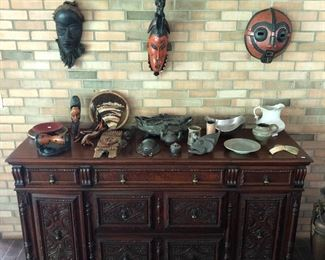 Berkey & Gay sideboard, highly carved with five drawers and two doors; sampling of numerous masks to be sold; exceptional selection of artwork from around the world.