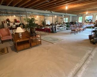 THE BASEMENT IS FULL OF FURNITURE AND HOLIDAY DECORATING ACCESSORIES