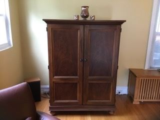 "Wood entertainment armoire, 46""x 25""x 62"" high, was $100, SALE $35"