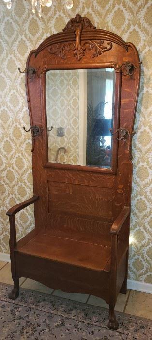 c1900's Honey Oak Hall Tree  American Made and still has original Beveled Glass Mirror