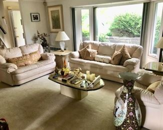 Living room with pair of leather sofas & chair