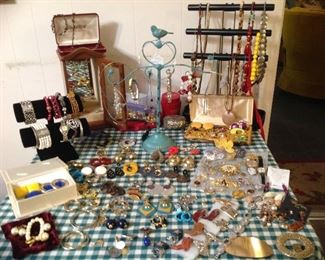 Table full of Jewlery - clip back earrings, rings, bracelets, pins, necklaces, combs, religious medals, belt buckles, cowboy boot pins, horse button covers