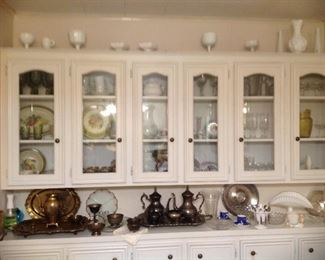 Wall of cabinets full of vintage dishes, vintage milk glass collection, pitchers, glasses, stems, salt and pepper shockers, silver plate serving pieces