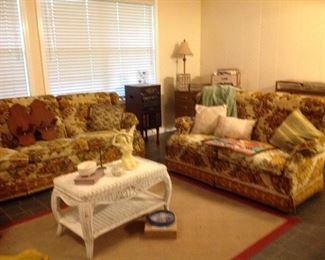 Henline sofa and matching loveseat, sofa cover, decorative pillows, wicker coffee table