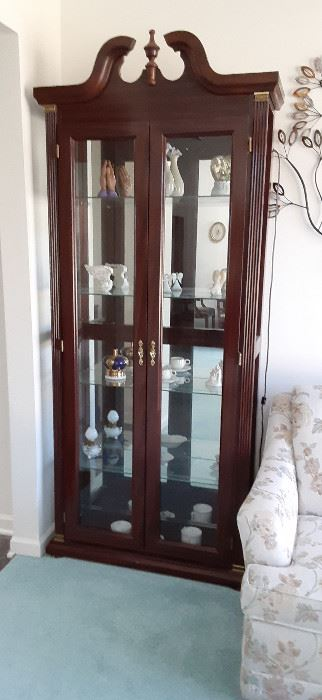 Lighted china/display cabinet.  Beautiful deep cherry.