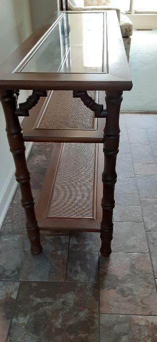 Nice sofa/entry way table.  Multipurpose with wicker-look shelves and removable glass top.