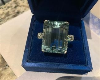 14 Kt. white gold aquamarine & Diamond Ring  Emerakd Cut 17.12 x21.5 x 10.97 MM  weighing approx. 32.00Ct.  Two Brilliant Cut Diamonds  measuring 4.50 MM and one measuring 4.55 MM, Clarity S1  Color H-1  appraisal  $10,500  July 2014