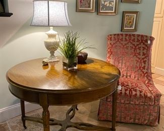 Round entry/center table, upholstered cut velvet chair, orchid paintings, accessories