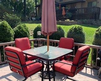 Patio glass top table with 4 chairs