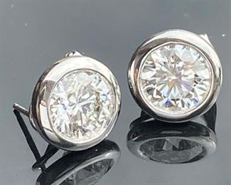 Pair of 14K White Gold Round Cut Diamond Earrings
