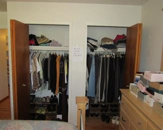 Tons of mens clothing with suits and pants and shoes