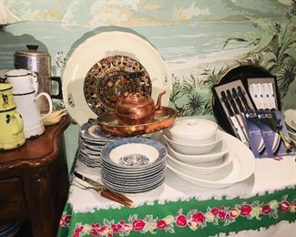 tables filled with vintage kitchenware plus two BRAND NEW in boxes of  Cutco knives