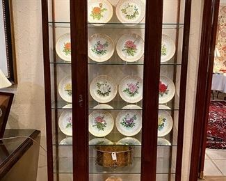 Boehm rose plates inside custom cabinet by William and Wesley.