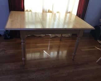 Dining Table with Leaf measures (59.5in L x 36in W x 29.5in H)