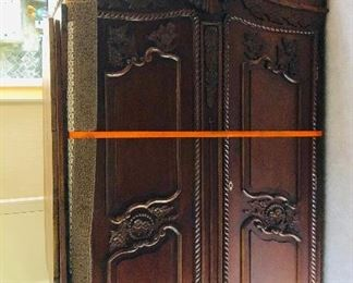 "Antique armoire professionally restored Beautiful detail. 96"" tall"