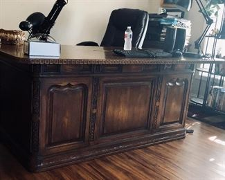 Beautiful wood attorney's desk.