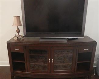 Beautiful cherry entertainment cabinet.  Glass doors, two drawers and shelving.  Excellent condition