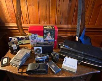 Vintage Cameras and camera equipment, slide projectors, movie cameras and reels
