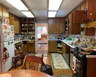 Many vintage kitchen items..cookware, appliances, serving ware, etc