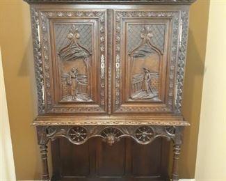 Antique hand carved break front bar cabinet