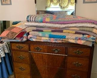 Beautiful dresser and a collection of vintage quilts that are in great shape
